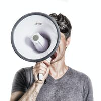 isolated portrait of a man shouting using a megaphone