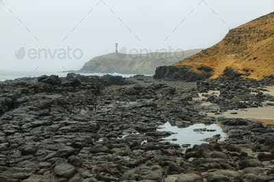 "Lighthouse from ""El Faraon or de la Isla"" beach in Puerto Supe, Barranca province, Peru"