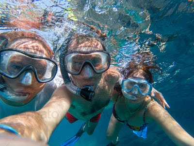 Underwater view of snorkeling friends