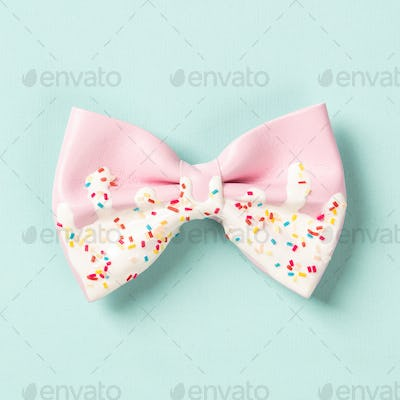 Cute hair bow on bright background, flat lay