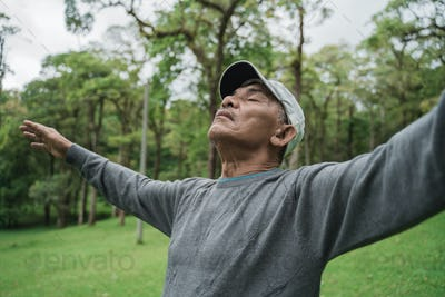 senior people take a deep breath stretch out and raise arm