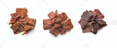 Beef jerky pieces.