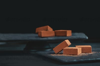 Soft chocolates in cocoa powder on a black background with copy space. Japanese gourmet chocolate