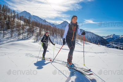 Uphill women with seal skins and ski mountaineering