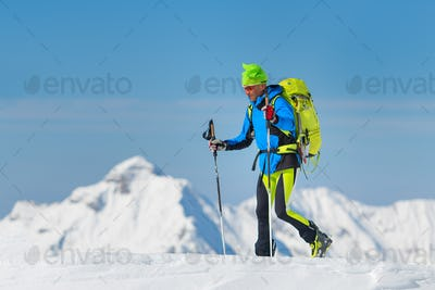 Man during a winter ascent in the mountains