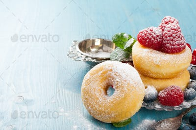 Morning breakfast with mini donuts and berries