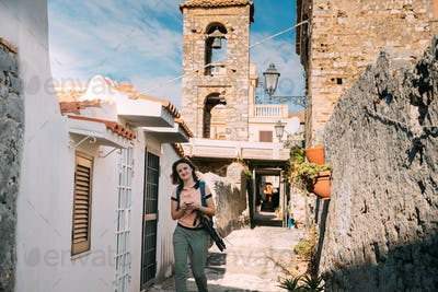 Terracina, Italy. Young Caucasian Woman Tourist Walking At Stree