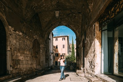 Terracina, Italy. Young Caucasian Woman Taking Photos In Gothic