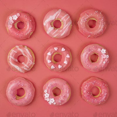 Sweet donuts on a living coral background