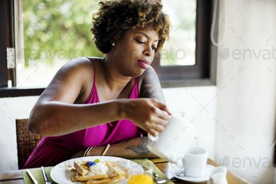 Woman having breakfast in a restaurant