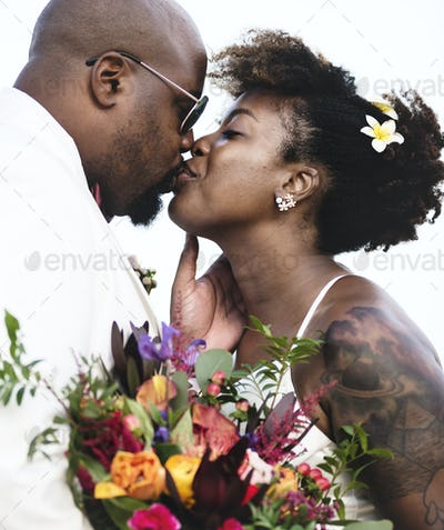 African American couple getting married at an island