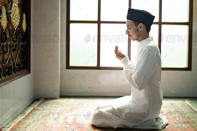 Muslim man making Dua to Allah