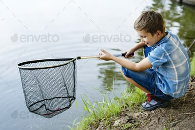 Boy fishing with a net