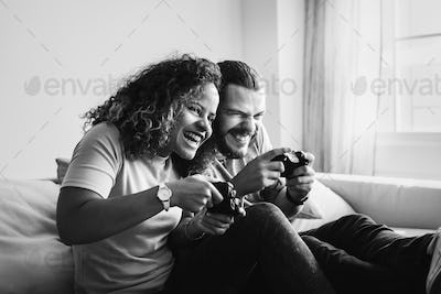Couple playing game at home together