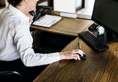 Female resort receptionist on the phone