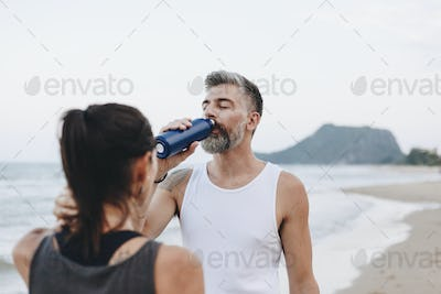 Man drinking water to rehydrate
