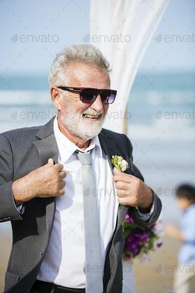 Senior groom at beach wedding