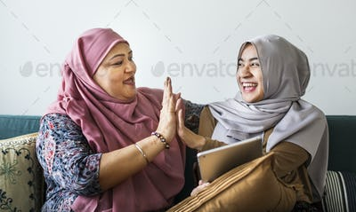 Muslim women using a tablet