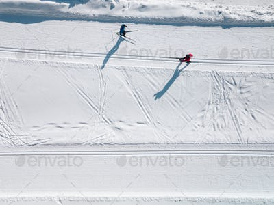 Aerial view of ski tracks in snow.  Men skiing in Finland.