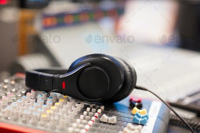 Headphones on Sound Mixer In Professional Radio Studio