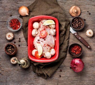 Raw chicken in baking dish