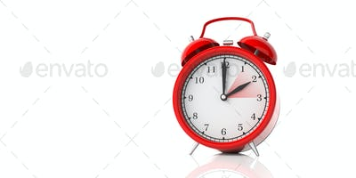 European daylight saving time end. Red alarm clock isolated on white background, copy space