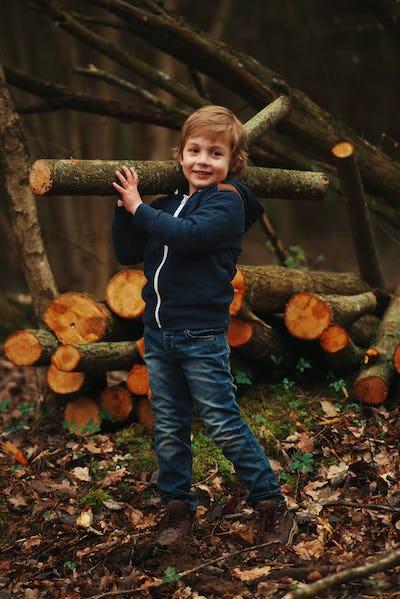 little sweet lumberjack in autumn forest