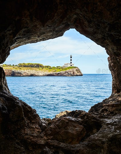 Portocolom Lighthouse seen from a cave, Mallorca.