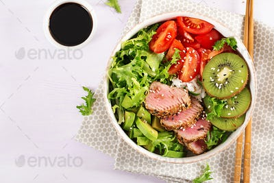 Traditional salad with pieces of medium-rare grilled Ahi tuna and sesame