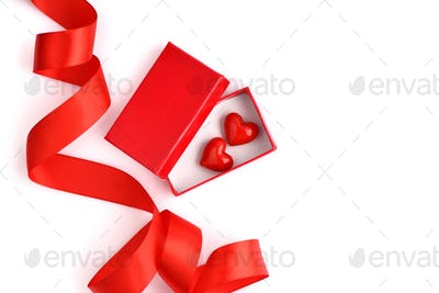 Valentines Day background. Two hearts in a red gift box with spa