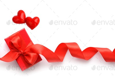 Valentines Day background. Two hearts and red gift box on white