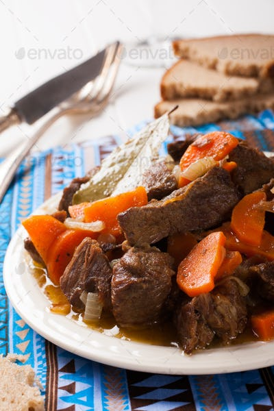 Delicious bourguignon beef stew on white plate