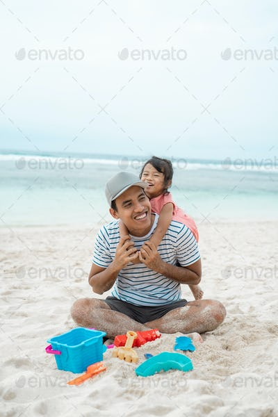 daughter embracing his father from behind when playing