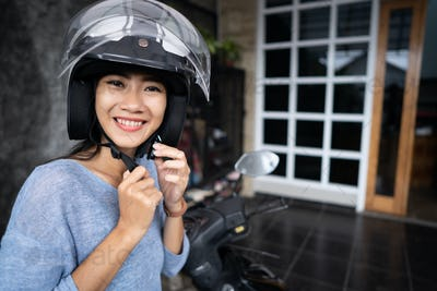 woman put a helmet on before going