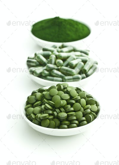 Green chlorella pills or green barley pills and powder.