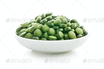 Healthy chlorella pills or green barley pills.