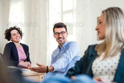 Group of young businesspeople working together in a modern office.
