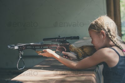 girl shoots a rifle in the dash