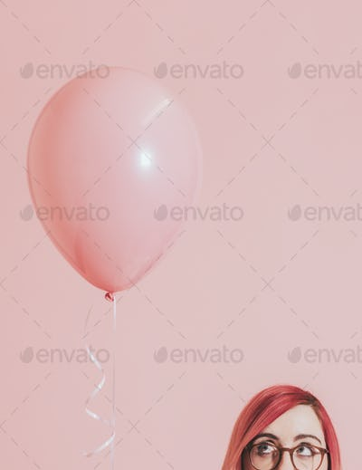 Pink haired girl with a balloon