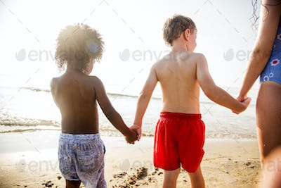 Kids holding hands at the beach