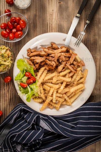 Greek gyros dis with fries and salad