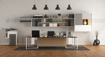 Modern office with desk and bookcase