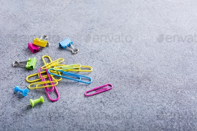 School supplies on gray stone background