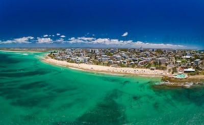 Aerial drone panoramic image of ocean waves on a Kings beach, Ca