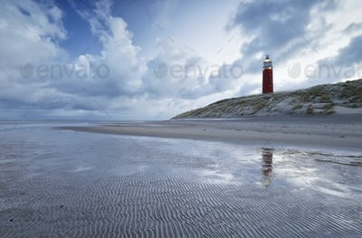 beautiful blue sky and clouds over red lighthouse