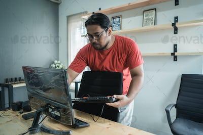 portrait of technician fix a computer