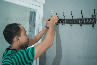portrait of asian young man working install a hangers