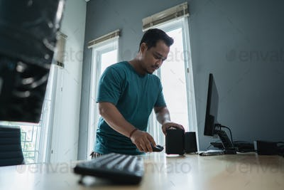 portrait of asian young man fix a problem of personal computer