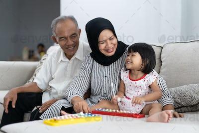 happy asian grandparent having fun with grandchild