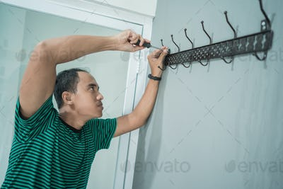 portrait of asian young man work with screwdriver